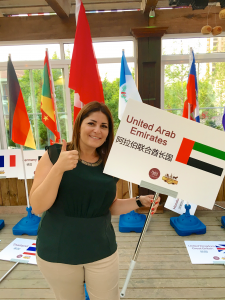Dima Sharif holding UAE Flag in China for winning the Gourmand World Cookbook Awards 2016