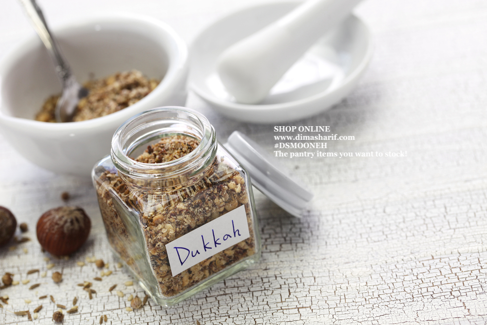 Dukka in a square glass jar with spices in a white bowl, Middle Eastern Spices